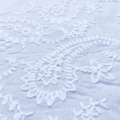 White embroidered cotton fabric